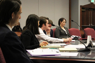 Mock trial students at the counselor's table look serious as they hear testimony.