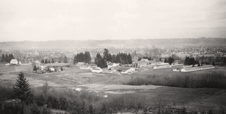 Western Washington Experiment Station fields and buildings. Puyallup Valley background.
