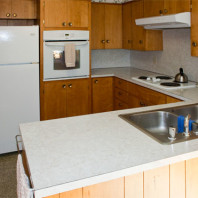 Kitchen with refrigerator, wall oven and food preparation areas..