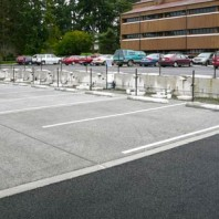 Permeable concrete parking lot with permeable asphalt lot in background.
