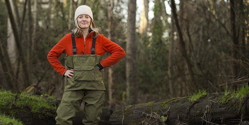 Dr. Jen McIntyer wearing waders in the forest.
