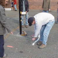 Marking the area where asphalt is to be removed and beds added.
