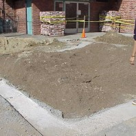 The footings for the curb surrounding the big bed.
