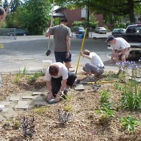 Installing pavers to create a path through the big bed