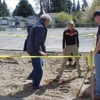 Examining the soil following asphalt removal.