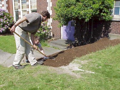 Spreading soil to create a base for the stairs.
