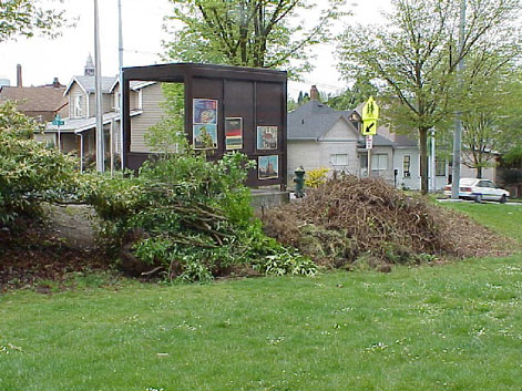 Mounds of removed plant debris waiting to be composted.
