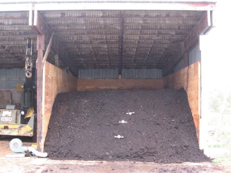 Photo of covered compost pile.