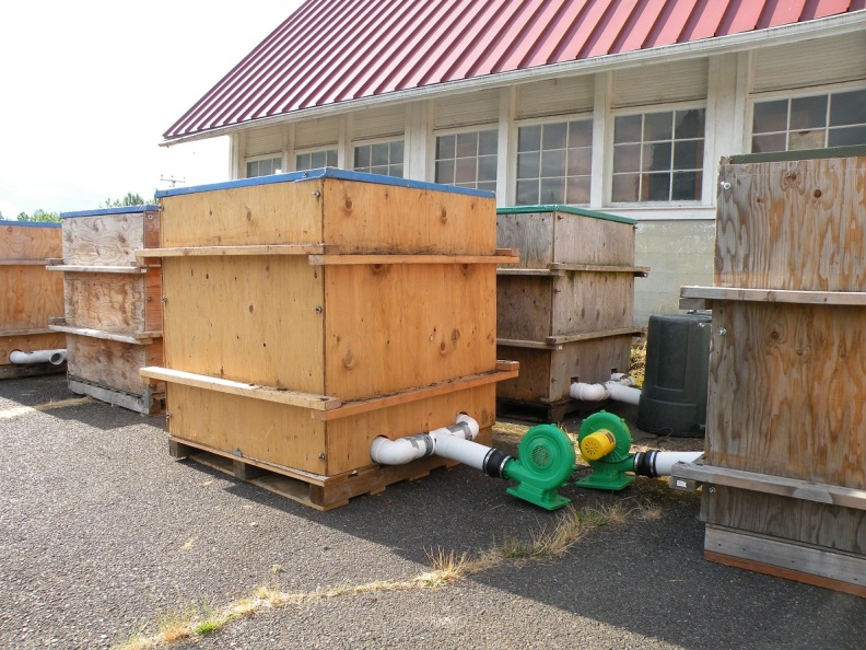 Photo of small compost bins.