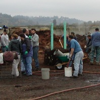 Group of people, long compost pile
