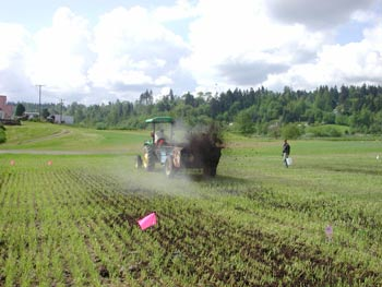 Photo of manure spreader spreading compost.