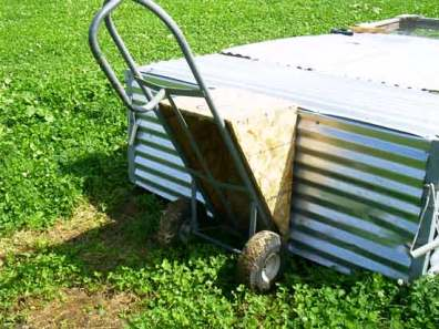Photo of pasture Poultry Cage, dolly and wedge used to raise rear of cage to move it.