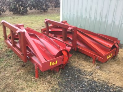 Photo of two Roller/Crimpers, front mounted on tractor to crimp cover crops stems to terminate them while leaving them in place to provide a mulch.