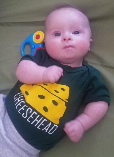 Baby wearing Cheesehead shirt