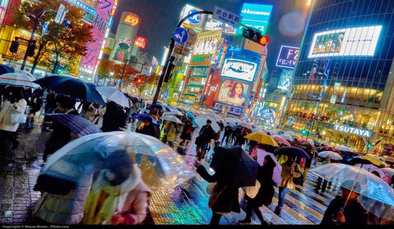 Photo of busy Tokyo street in the rain, by Moyan Brenn