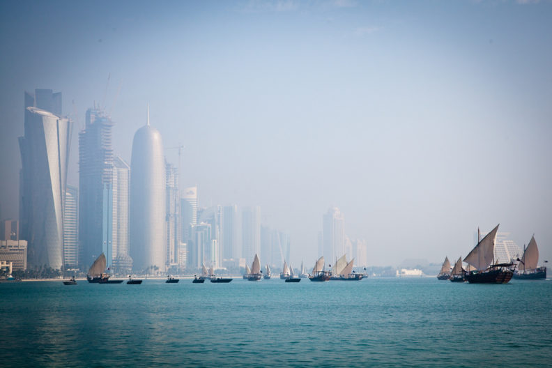 Boats on waterfront in Qatar, photo by Omar Chatriwala