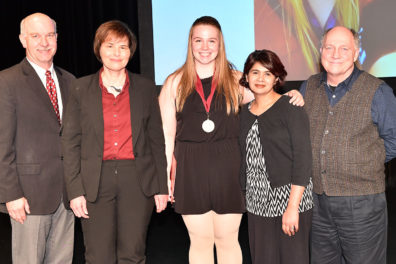 Anna Cole with dean and faculty upon receiving her Outstanding Senior medal