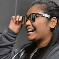 Student tries on sunglasses
