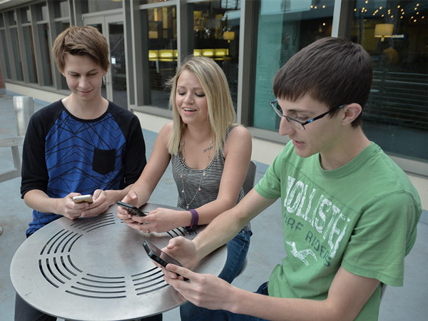 Students looking at smartphones