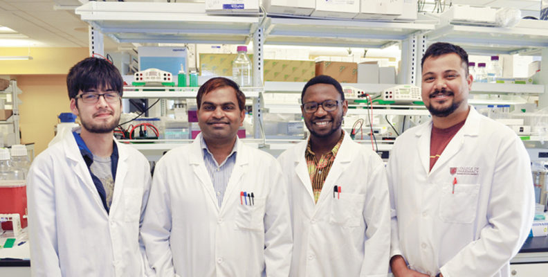 Researcher Shobhan Gaddameedhi with three of his graduate students in the lab