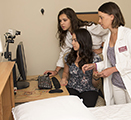 Research assistants Samantha Riedy, Regan Permito and Beth Lewis review a cognitive performance test while preparing for a sleep deprivation study at WSU Spokane.