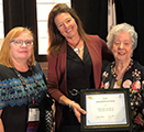 Andra Davis accepts the Dorothy Otto Research Award at the National League for Nursing Education Summit. She is flanked by College of Nursing dean Joyce Griffin-Sobel and Dorthy Otto, associate professor emerita a the Cizik School of Nursing at the University of Texas.