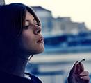 Young woman smoking marijuana