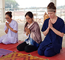 WSU College of Nursing PhD student Shandeigh Berry, right, participates in guided meditation while at Arokhayasala Khampramong Temple in Sakon Nakhon, Thailand, in March 2019.