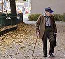 Image showing older man with cane walking through an urban neighborhood