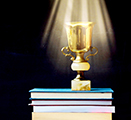 Illustration of an trophy on top of a pile of books, with a spotlight shining on it