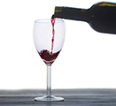 Photo of red wine being poured into a glass