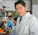 Zhenjia Wang is shown in his lab at WSU Spokane