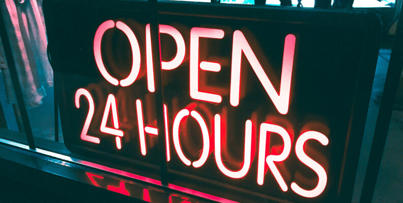 """Photo of lighted """"Open 24 hours"""" sign"""