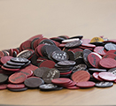 Tokens used in prize drawings as part of the contingency management intervention. Some simply say 'good job' while others can be exchanged for prizes ranging in value from $1 up to $80.
