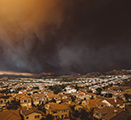 Image of wildfire smoke-filled skies above a town