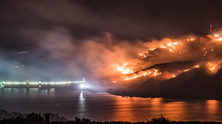 Image of wildfires lighting up a hill at night