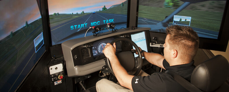 Researcher Steve James operates a driving simulator used for studies related to fatigue.