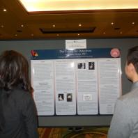 Undergraduate students examine a poster.