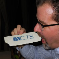 Craig Hemmens takes a bite out of an ACJS white chocolate bar.