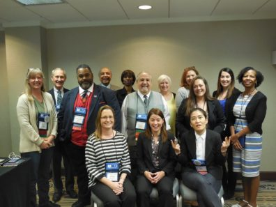 Professor Faith Lutze with about a dozen other ACJS members.