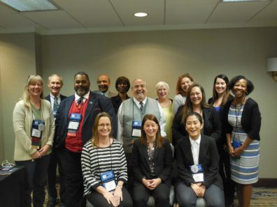 Professor Faith Lutze with about a dozen other ACJS members - in a somewhat more serious pose..