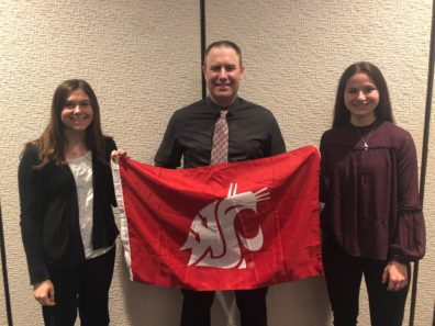 CrimJ faculty and students display the WSU Cougar flag.