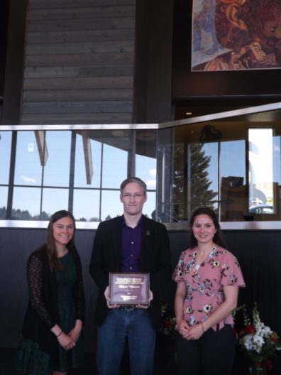 Oliver Bowers, center, holds his award placque, flanked by students Samantha Bill & Emma Smith.