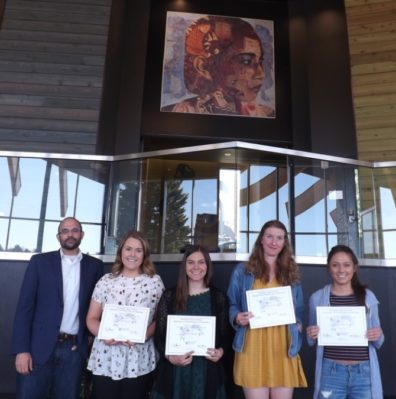 Dr. David Makin stands with students Emily Barlett, Samantha Bill, Mackenzie Jeter, & Ivania Ordonez, who are displaying their award certificates..