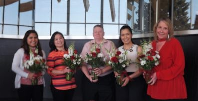 Jackie Baltazar, Sisouvanh Keopanapay, Tina Krauss, Rebeca Orozco, & DeeDee Torgeson stand with floral bouquets of appreciation.