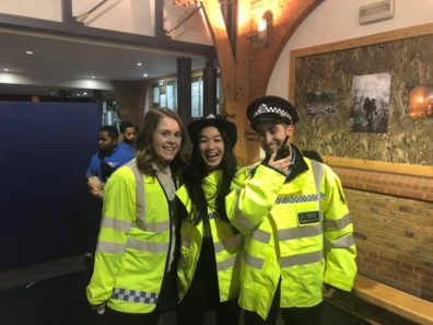 Graduating Criminal Justice and Criminology major Emily Bartlett, senior Criminal Justice and Criminology major Kaitlin Saythong, and graduating Criminal Justice and Criminology major Griffin Patrick wear Metropolitan Police uniforms during a visit with the Metropolitan Police Youth Cadets Program.