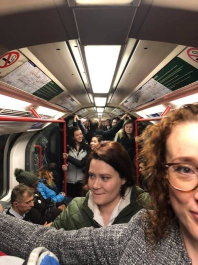 Criminal Justice and Criminolgy Study Abroad students packed in a morning London Underground car en route to a program visit.