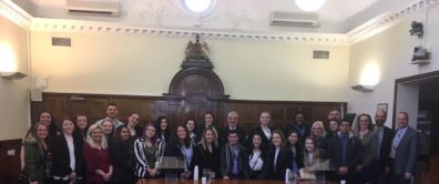Joint Washington State University and University of Idaho Criminal Justice and Criminology Study Abroad program students and faculty pose with Andrew Harris, senior coroner at the Southwark Coroner's Court in London's Inner South District, after a visit and presentation.
