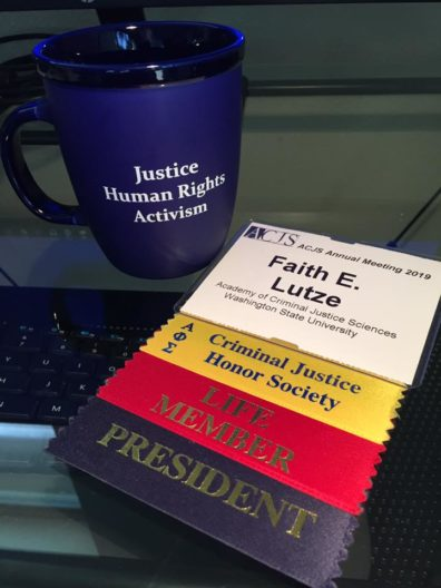 Faith's ACJS cup and conference ribbons.