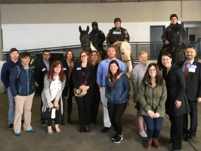 Alumni Drs. Amber Morczek and Wendy Koslicki (bottom right) at the Baltimore Police tour.
